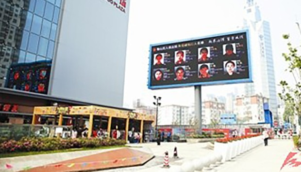 Debtors in China Shamed on Highway Billboard Featuring Their Faces and Names