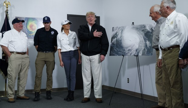 Climate change? It goes back and forth, says Trump on storm damage tour