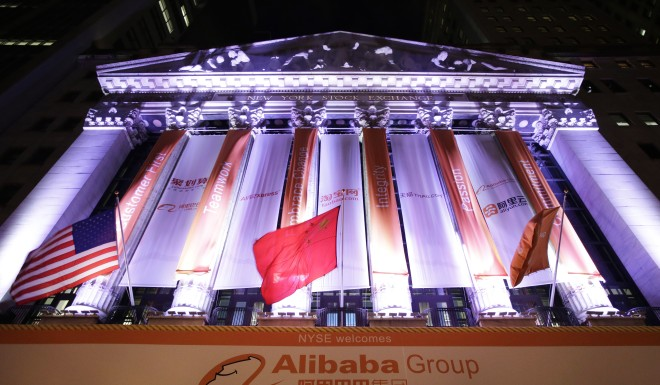 A Chinese flag  waves over a banner for Alibaba on the New York Stock Exchange on September 19, 2014.