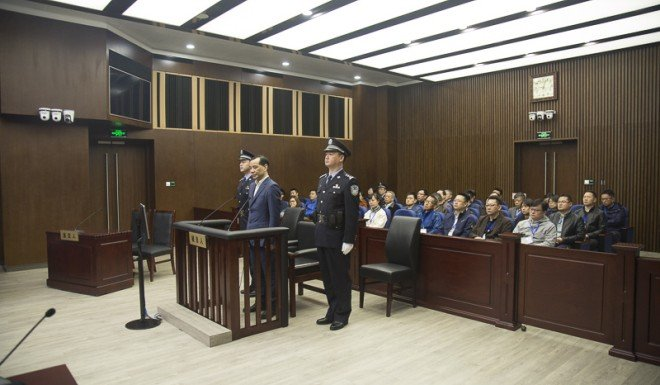 Wu Xiaohui contests all charges during his trial on Wednesday.