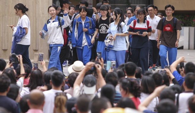 Students walk out of an exam site in Beijing after finishing the 2017 gaokao. It is the end of a 12-year ordeal.