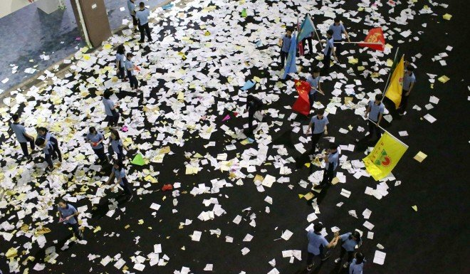 Students scatter textbook pages onto the ground in a stress-release exercise before the gaokao.