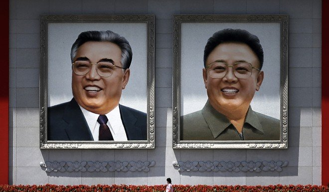 Kim Jong-un has inherited the hairstyle of his grandfather Kim Il-sung (left) and father Kim Jong-il.