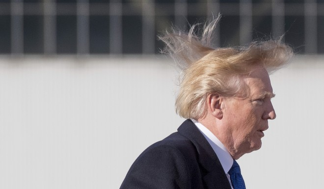 Trump's hairdo has not fared well in the wind.