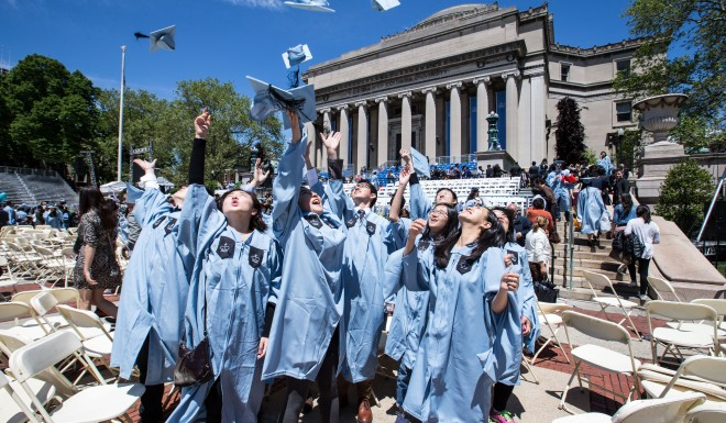 A group of Chinese graduates celebrate after commencement at Columbia University in 2016.