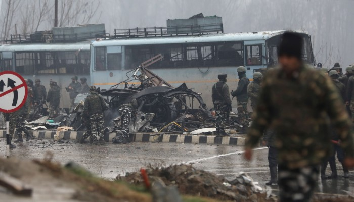 Indian security officers inspect the site of the blast in Jammu and Kashmir's Pulwama district on Thursday. Photo: EPA-EFE