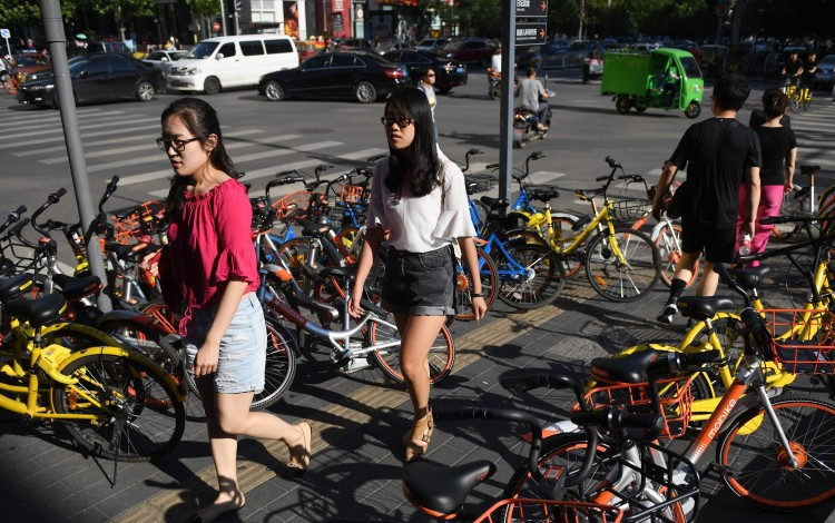 China's first listed bike-sharing firm surges in Shanghai debut
