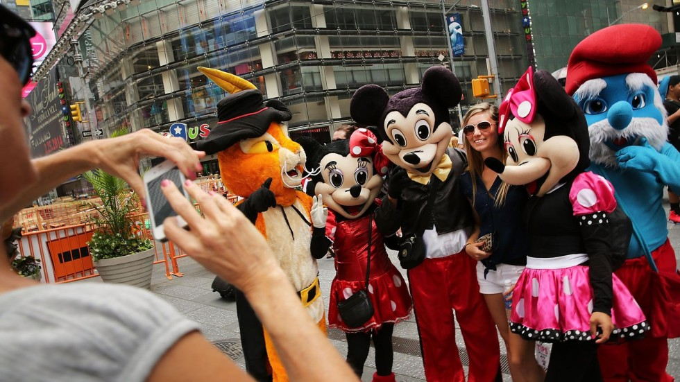 times square cartoon characters a headache for new york authorities