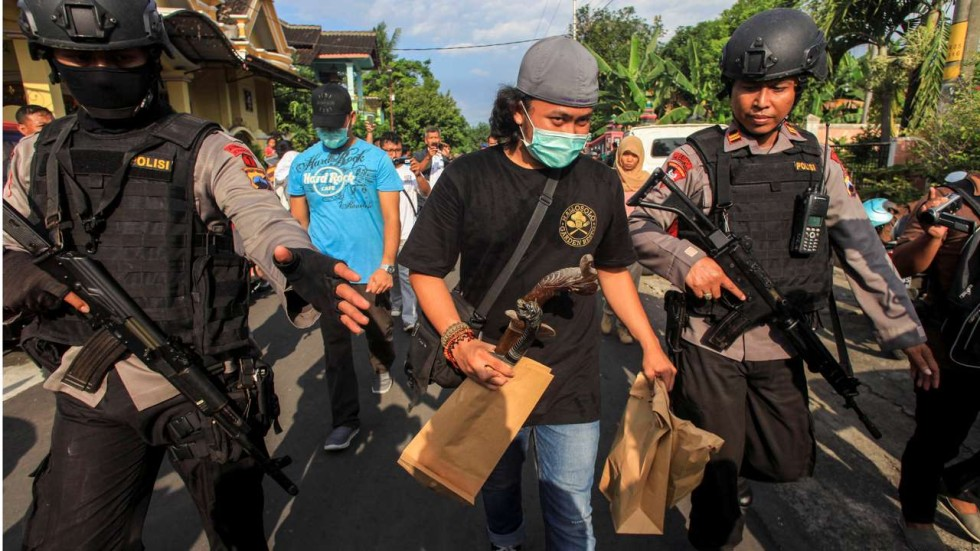 Image result for police carry raid over valentine in indonesia