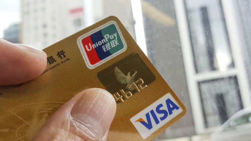 China orders banks to stop issuing dual-currency credit cards to ...