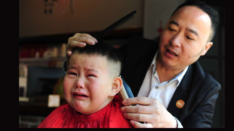 In Pictures As Dragon Raises Its Head Chinese Get Haircuts On