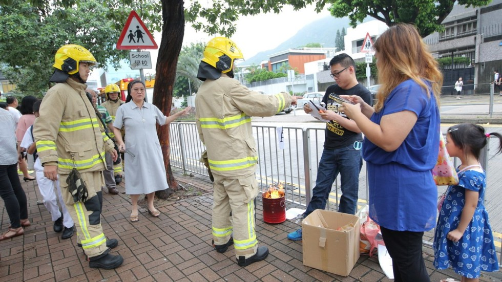 Protesting Pas Burn Test Papers Outside Hong Kong School