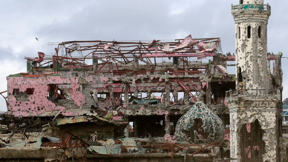 liberated philippine city lies in ruins as its people seethe south