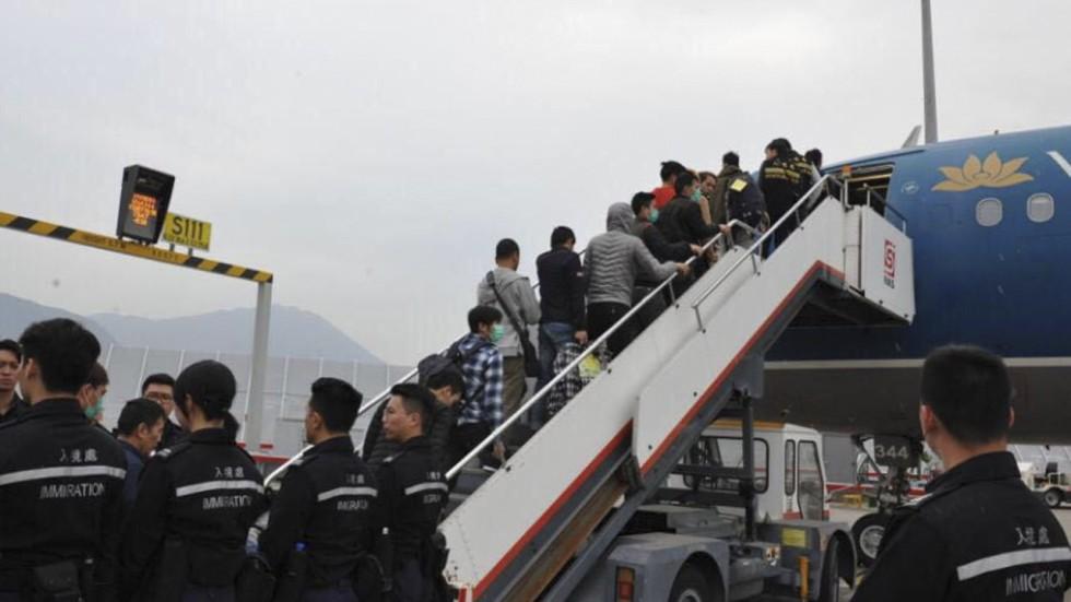 Unsuccessful asylum seekers illegal immigrants in hong kong sent unsuccessful asylum seekers illegal immigrants in hong kong sent back on chartered flight to vietnam stopboris Image collections