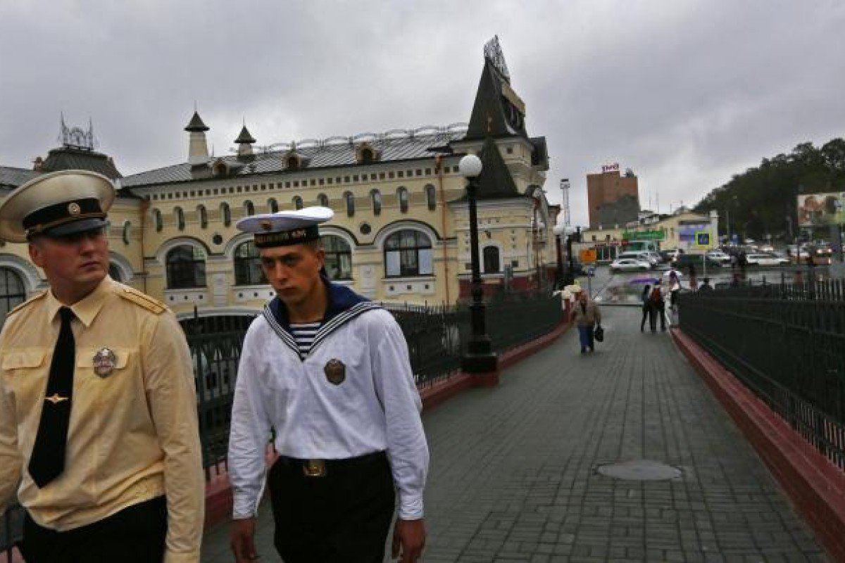 Sailors walk away from the city's railway station. Photo: AP