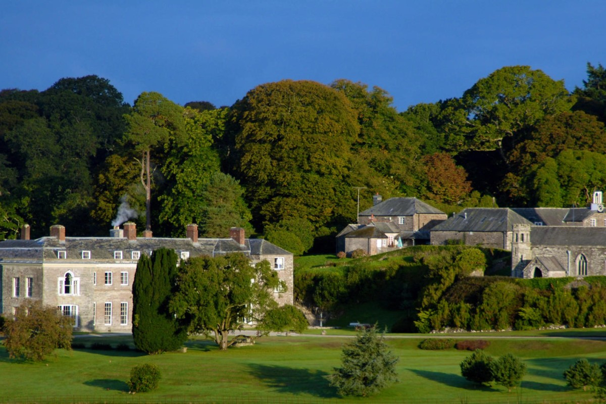 Boconnoc House with the church and stables in view.