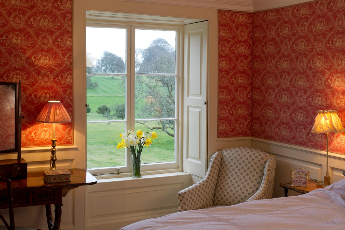 A glimpse of the lush grounds from one of the bedrooms.