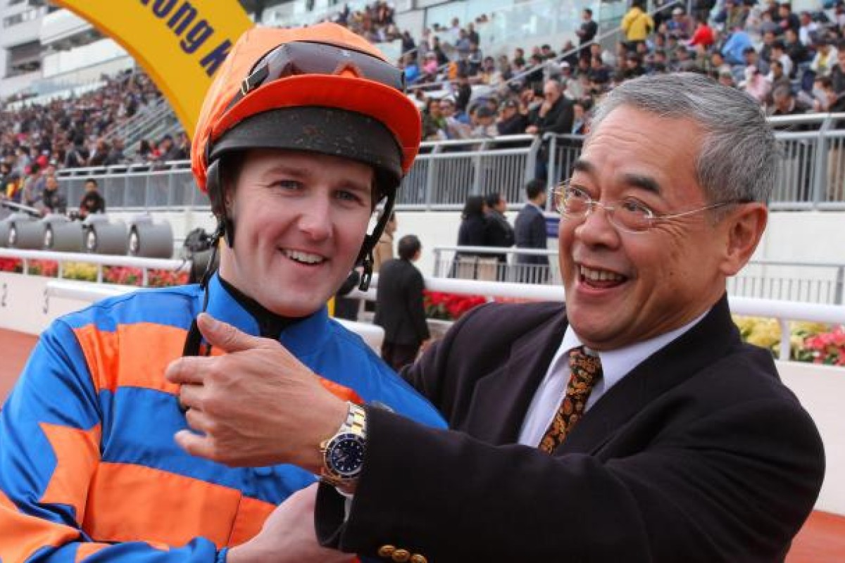 Tom Queally enjoys his moment with trainer Peter Ng.