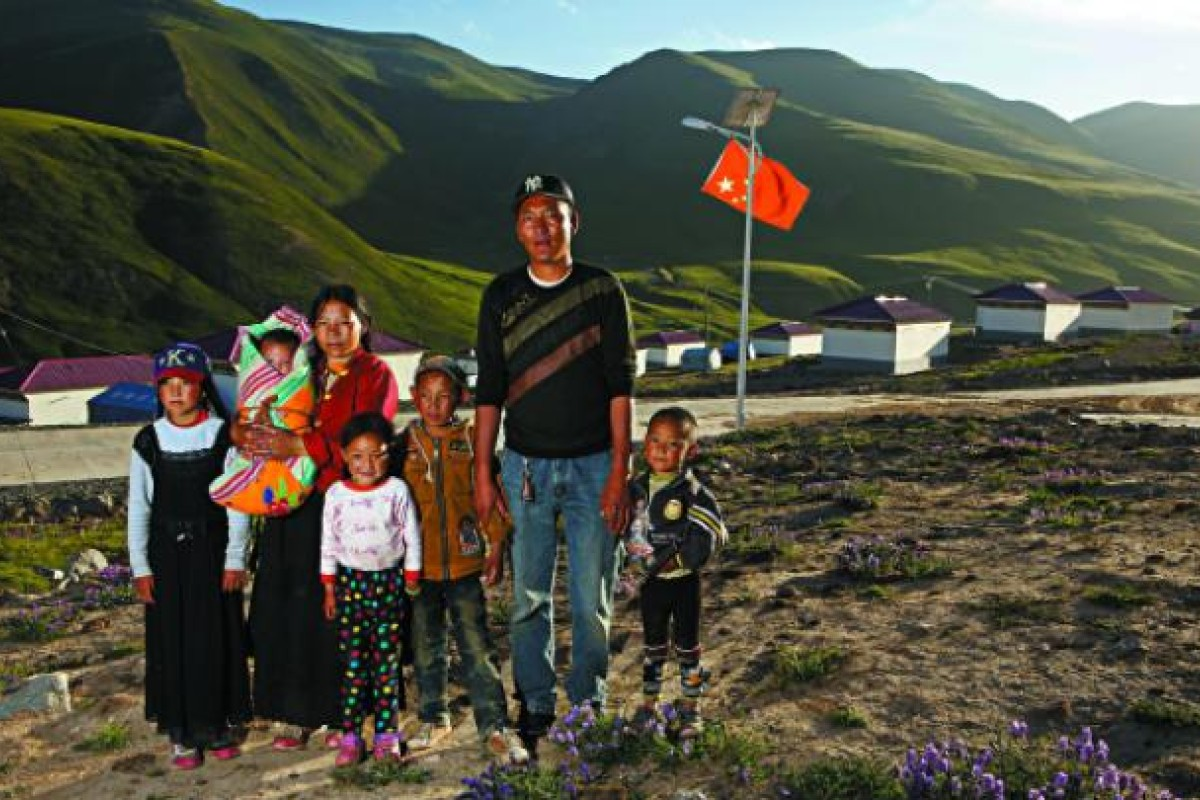 """""""Life is perfect,"""" says a father-of-five taxi driver in Ganda village, Yushu county. Ganda is used to show visiting officials the success of the ecological resettlement policy."""