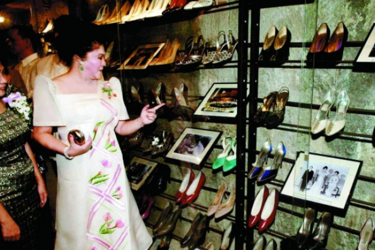 Imelda inspects part of her shoe collection at the Marikina Shoe Museum, Manila.