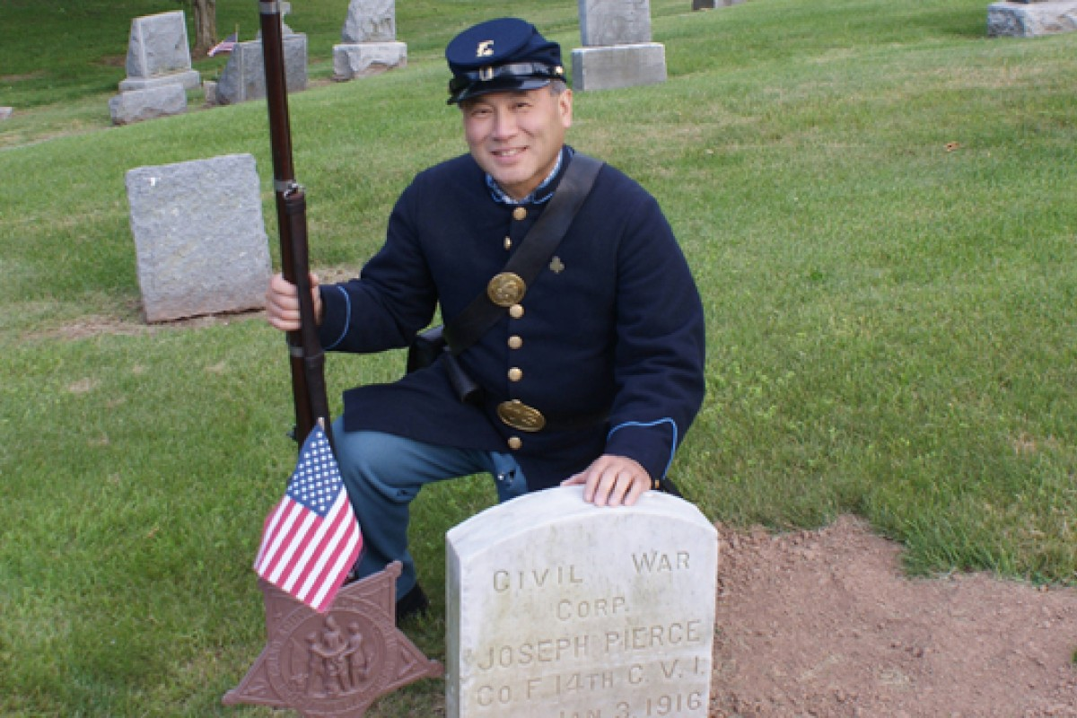 Irving Moy, dressed as Joseph Pierce, at the latter's gravesite in Meriden, Connecticut.
