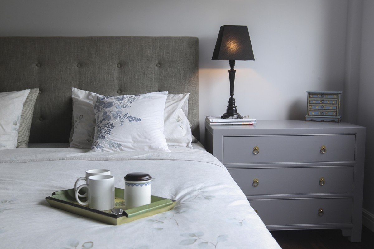 Master suite: In a variation on the all-grey scheme, Wong introduced taupe and purple-grey shades in the master suite. The bed (headboard, HK$8,590; upholstered base, HK$6,990; base cover, HK$1,690) was from Indigo. The chest of drawers (HK$3,800) came from My Woodz (12/F, Sungib Industrial Centre, 53 Wong Chuk Hang Road, Aberdeen, tel: 9522 6384). The lamps were purchased a decade ago from a shop that has since closed.