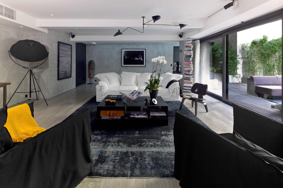 Living room: Lending 1950s style to the spacious living area is a Serge Mouille ceiling light (HK$48,000) that came from Magazzini (Ruttonjee Centre, 11 Duddell Street, Central, tel: 2521 3282). The black Ghost by Gervasoni armchairs (HK$10,000 each), by Paola Navone, came from Lane Crawford Home Store (Pacific Place, Admiralty, tel: 2118 3668), which was also the source for the white Linteloo sofa (HK$70,000) by the same designer. The kilim carpet was bought in Istanbul, Turkey, years ago. The coffee table (HK$8,000) was designed by Bels and will soon be sold at Eclectic Cool (58 Po Hing Fong, Sheung Wan, tel: 5699 6882). The enormous Lamp Pallucco (HK$30,000), by Mariano Fortuny, was from Silvera (www.silvera. fr) and the Eames chair (HK$10,000) from Sentou, in Paris (www.sentou.fr). The Ptolomeo bookshelf (HK$9,000) came from Lane Crawford Home Store. The photo of Mick Jagger, by Claude Gassian, came from A. Galerie, in Paris (a-galerie. fr), as did the abstract artwork, by Teresa Aninat.