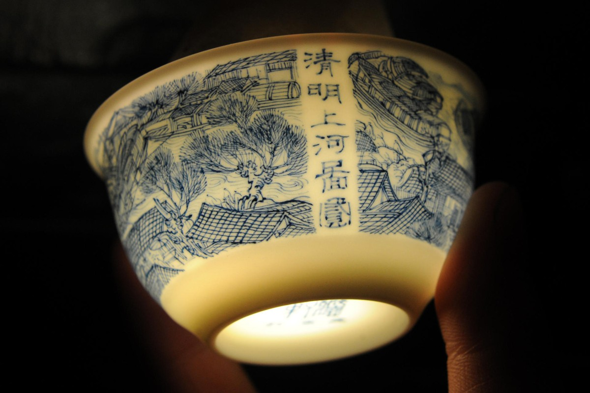 A tea cup adorned with a copy of the famous painting Riverside Scene at Qingming Festival by Jingdezhen-based artist Liu Zhen.