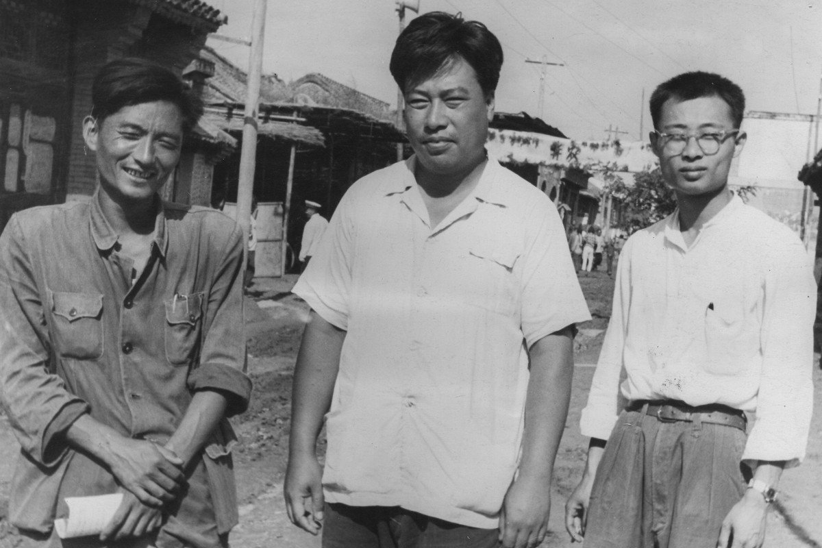 Central Philharmonic violinist Zhu Xinren (right), with conductor Li Delun (centre) and a peasant, worked as a labourer in the countryside in 1958 before being called up to perform with the Dresden Philharmonic.