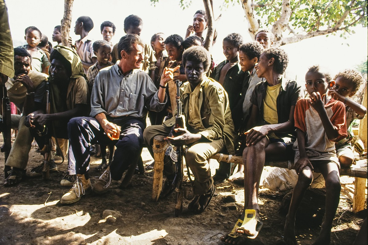 From the same series, Palin takes tea with village children and teenage soldiers from the Ethiopian People's Revolutionary Democratic Front, near the country's border with Sudan.