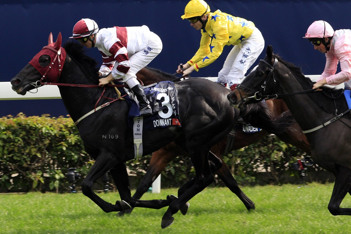 Dominant (Zac Purton) beats The Fugue (outside) and Dunaden in the HK$15 million Longines Hong Kong Vase at Sha Tin on Sunday. Photos: Reuters