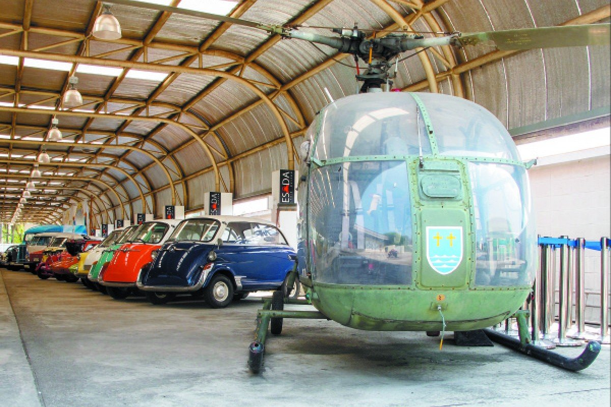 A helicopter makes an incongruous first exhibit in a line-up of bubble cars.