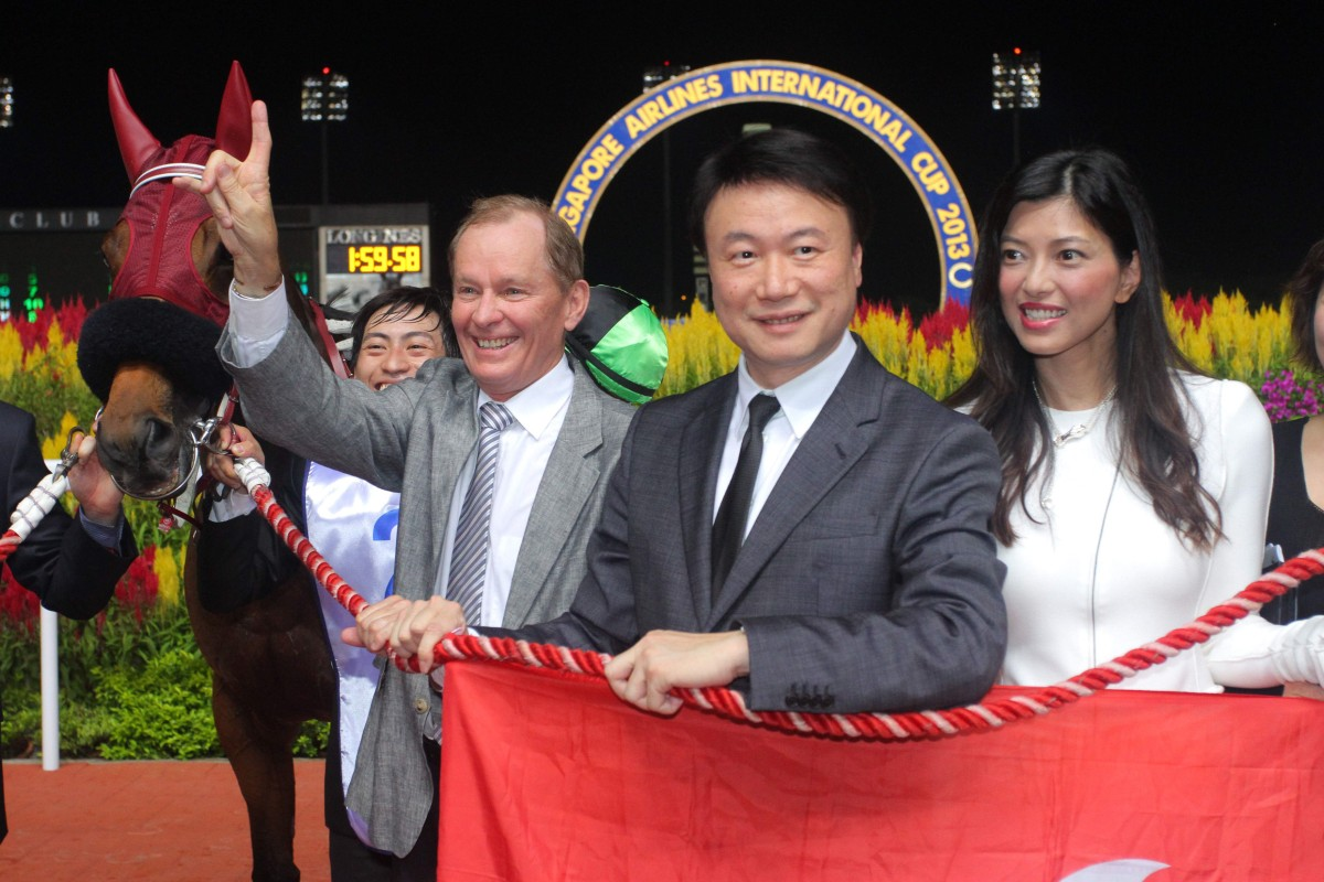 Steven Lo and his wife, pictured with trainer John Moore and Military Attack. Photo: Kenneth Chan