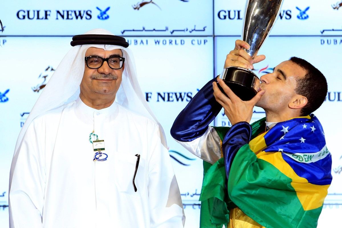 Joao Moreira, draped in the Brazilian flag, kisses the Golden Shaheen trophy after his second win of Dubai World Cup night. Photos: EPA, Kenneth Chan
