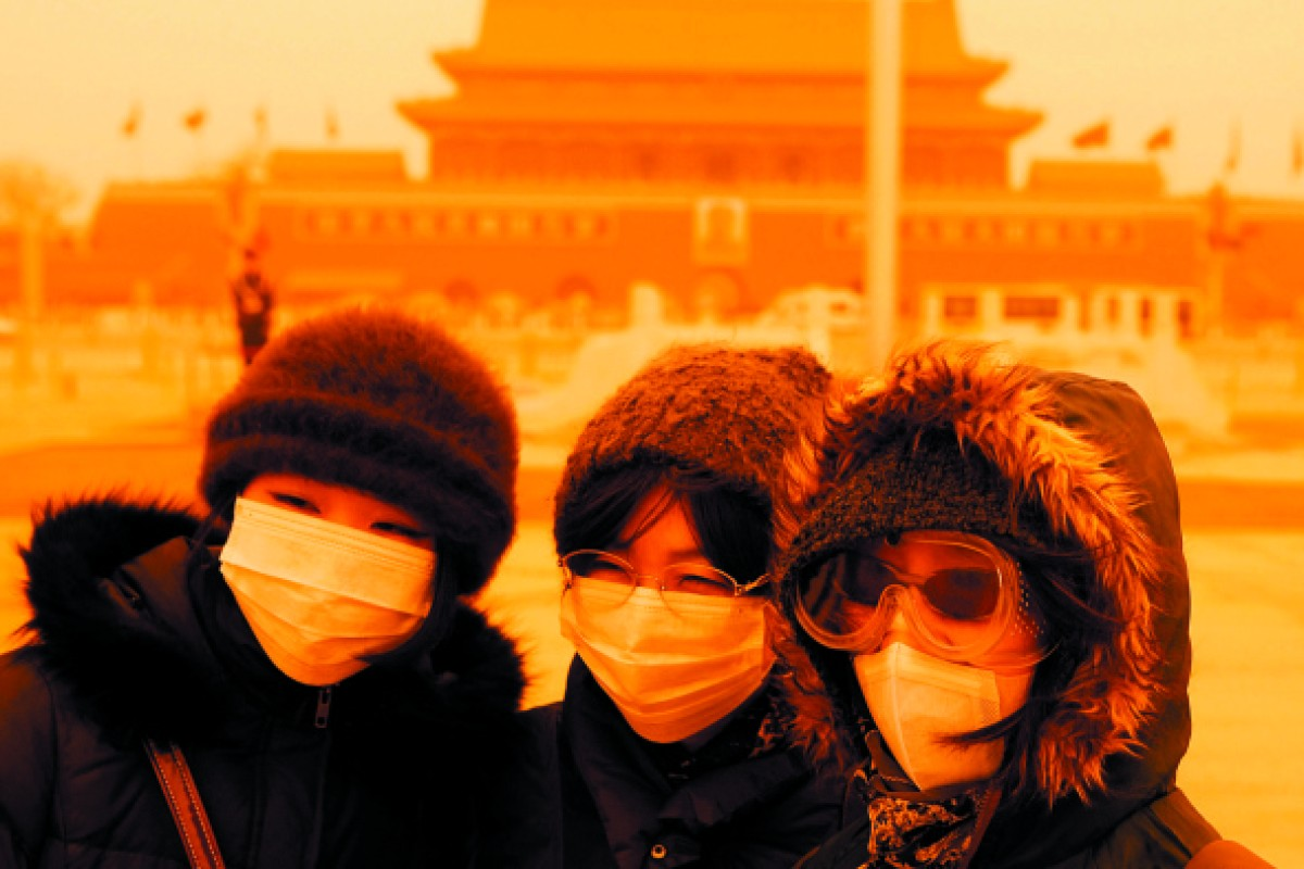Tourists in Beijing's Tiananmen Square following a severe sandstorm in March 2010.