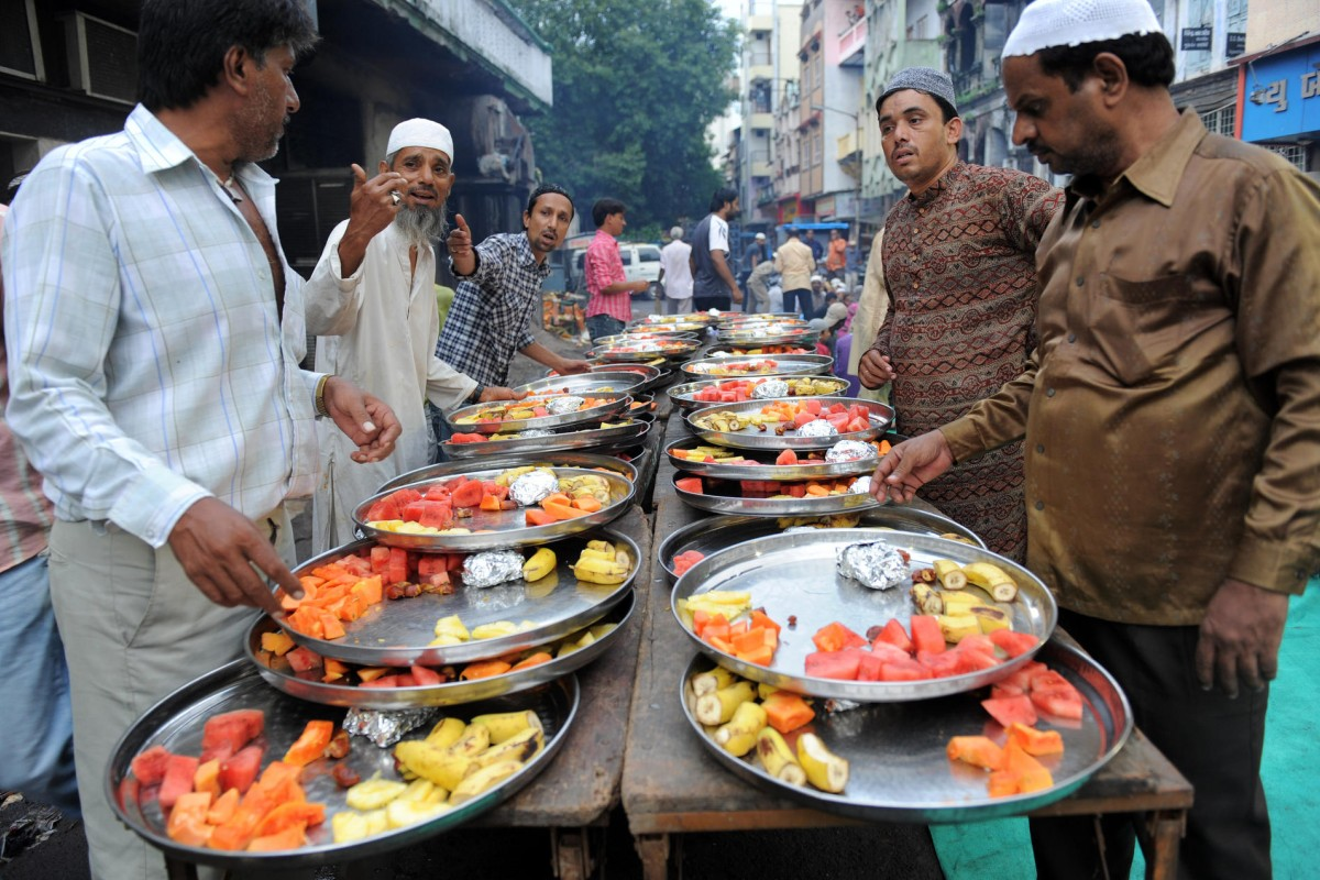 Muslim volunteers in Ahmedabad prepare food for a fast-breaking Iftar party during Ramadan. Photos: AFP