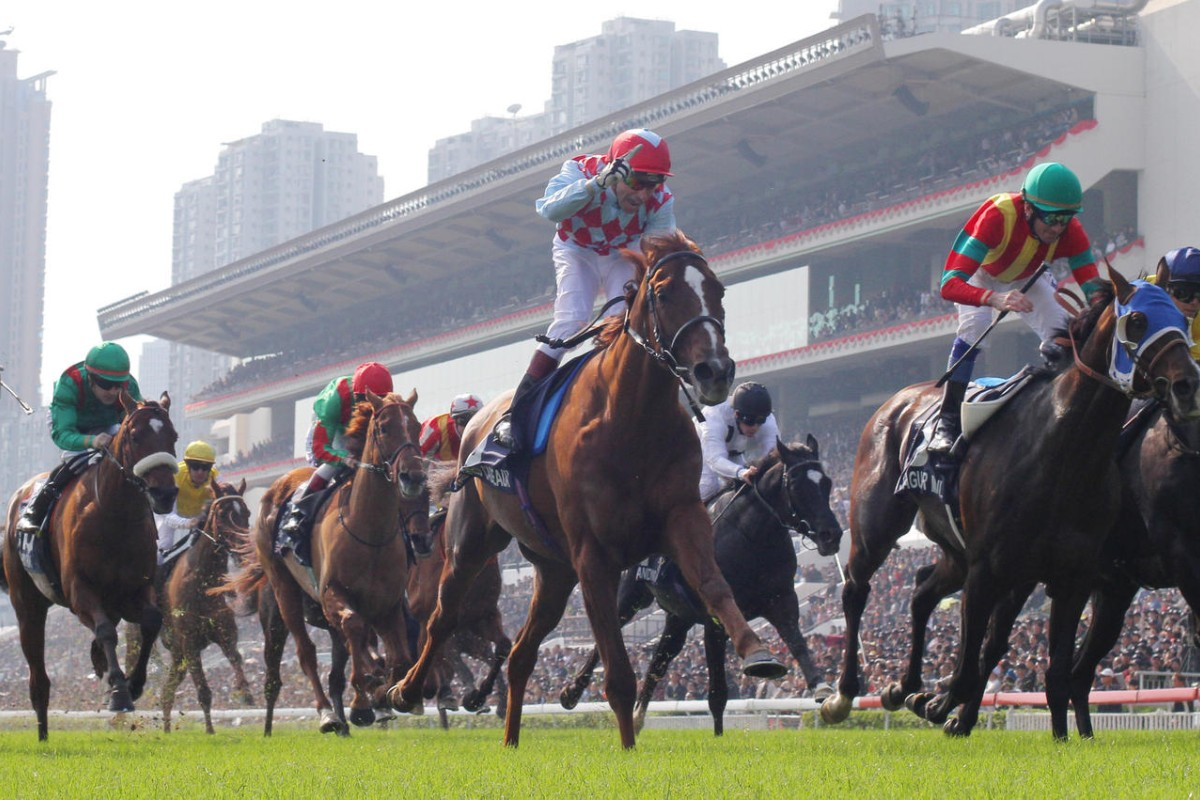 Ronald Arculli's seasoned traveller, Red Cadeaux, ridden by Gerald Mosse, wins the Hong Kong Vase at Sha Tin in 2012. He is lining up once again for honours this year on his fourth visit to Hong Kong. Photos: Kenneth Chan
