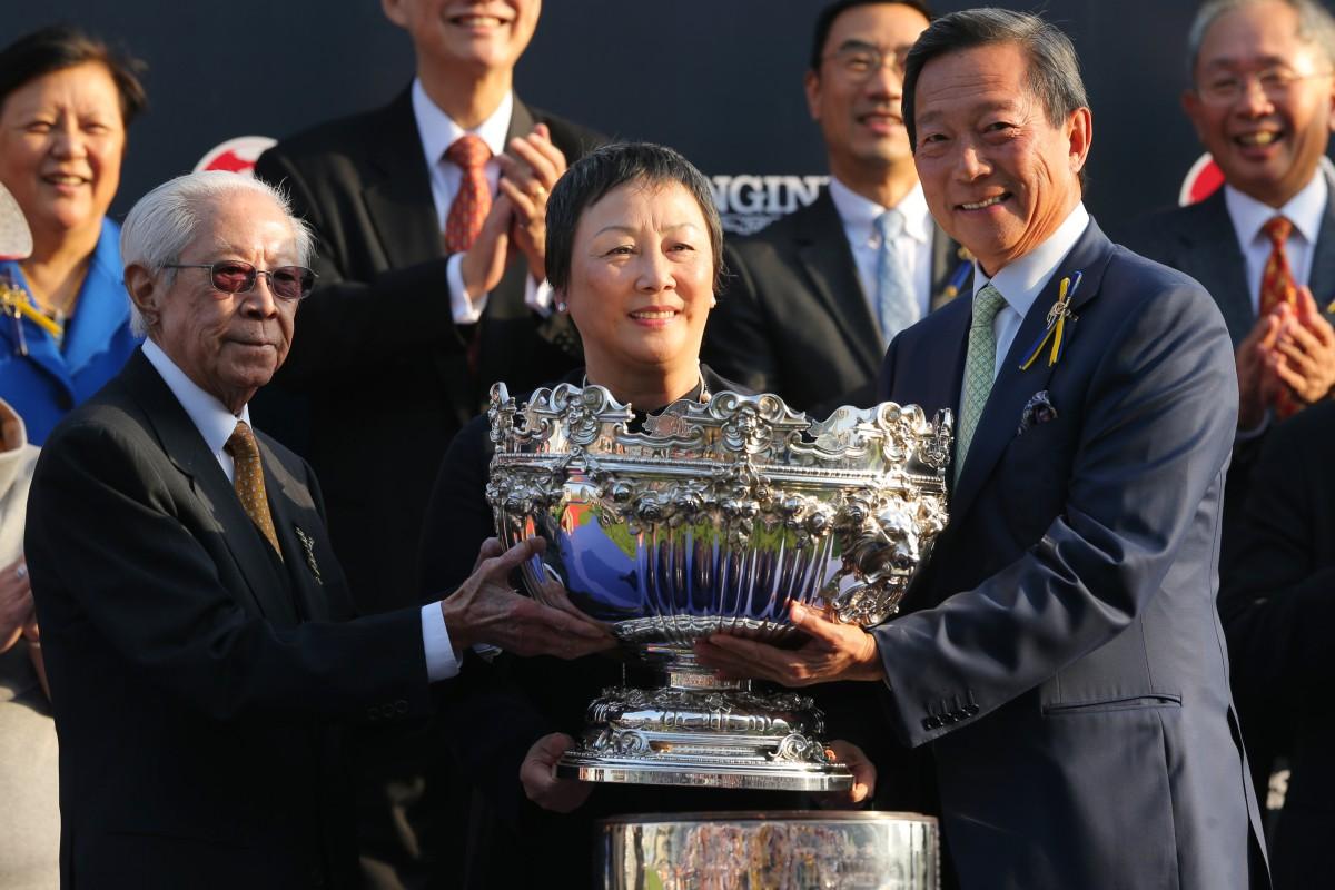 Cornel Li receives the Hong Kong Mile trophy from Jockey Club chairman Simon Ip Sik-on. Photo: Kenneth Chan
