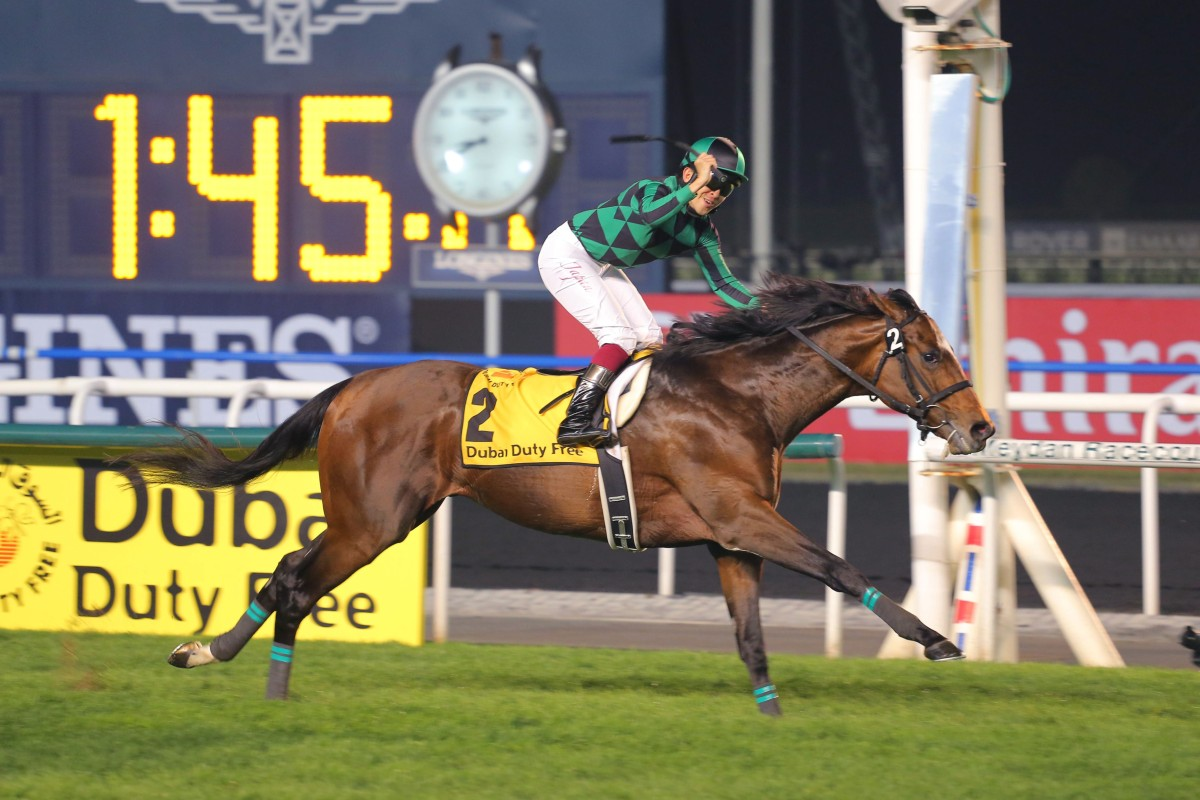 Yuichi Fukunaga salutes as Just A Way wins the Dubai Duty Free comfortably. He will be named the world's best racehorse of 2014 in London next week - but would he win the award if a different format was used? Photo: Kenneth Chan