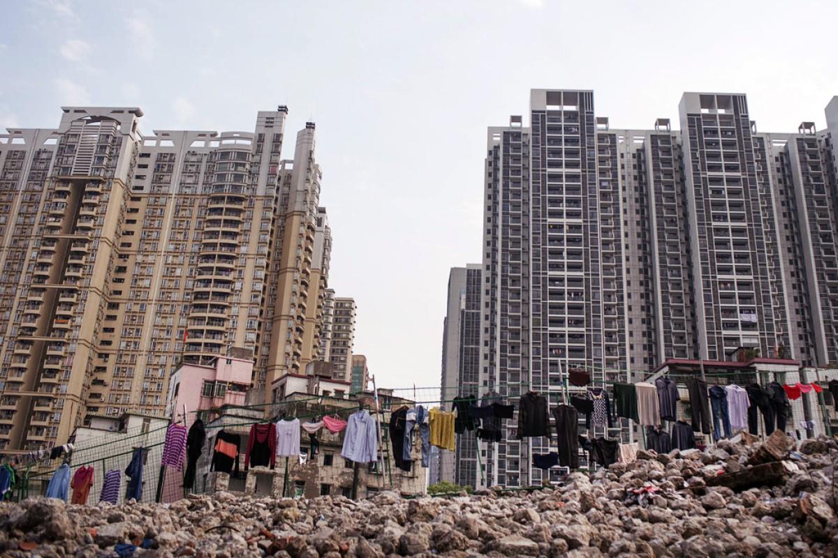 New apartment blocks in Guangzhou. Photos: Matjaz Tancic; An Ge; Thomas Bird; Corbis