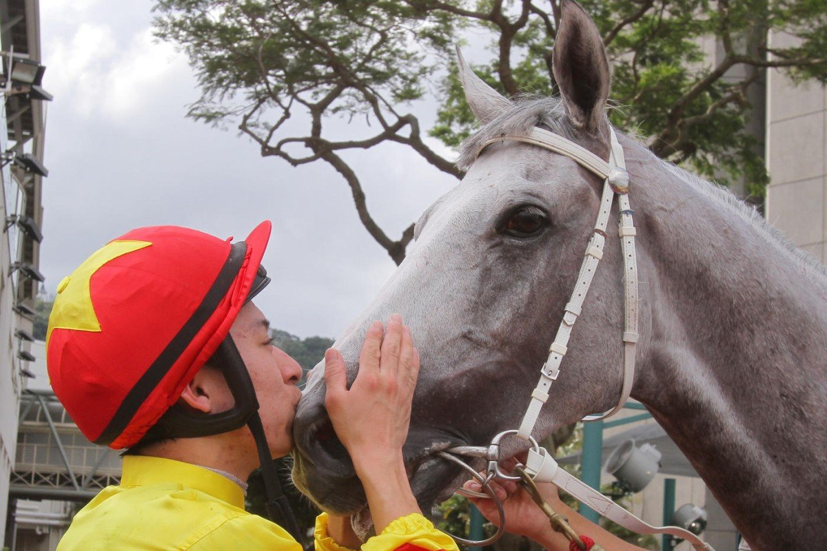 Jockey Matthew Chadwick kisses his friend California Memory after they won the Champions & Chater Cup at Sha Tin in 2013, their last major win. Photos: Kenneth Chan