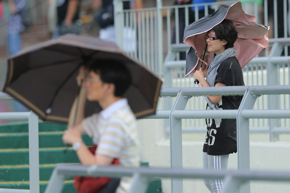 A wet and windy day, brought on by Typhoon Mujigae, caused attendance to plummet and turnover to drop on a day already affected by the absence of star jockeys Joao Moreira and Zac Purton. Photo: Kenneth Chan