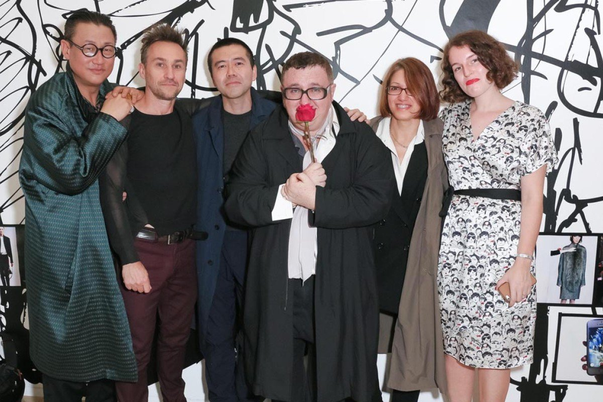"""Alber Elbaz (third from right) with guests at the """"Alber Elbaz x Lanvin: Manifesto"""" exhibition during Paris Fashion Week."""