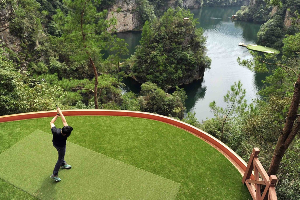 Novelty golf promotions in China, like this shoot-out into a lake in Hangjiajie, Hunan province, are unlikely to be seen again after President Xi Jinping's crackdown. Photo: Reuters