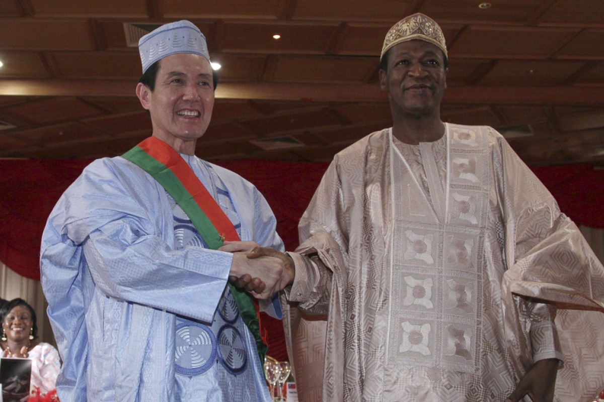Taiwanese President Ma Ying-jeou with then leader Blaise Compaoré, during a state dinner in Burkina Faso, in April 2012. Photos: AFP; Corbis; Ivan Broadhead