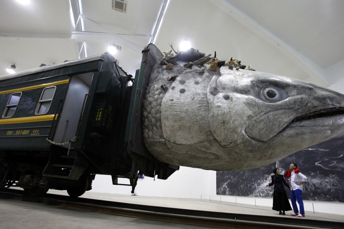 "An installation art work entitled ""Leviathanation"" by Huang Yongping features a giant fish head made from fiberglass, stuffed animals and a train. Photo: AP"