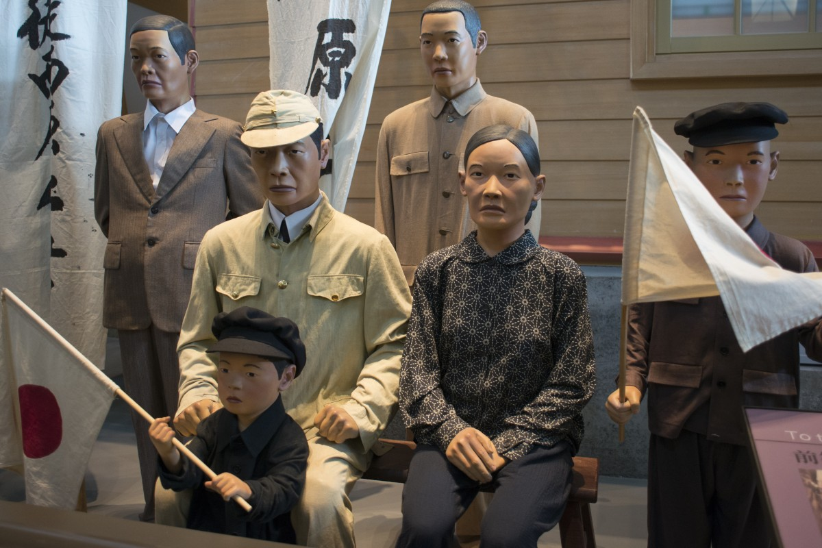 A display, representing a Taiwanese soldier about to go off to fight for Japan in the second world war, at the National Museum of Taiwan history.