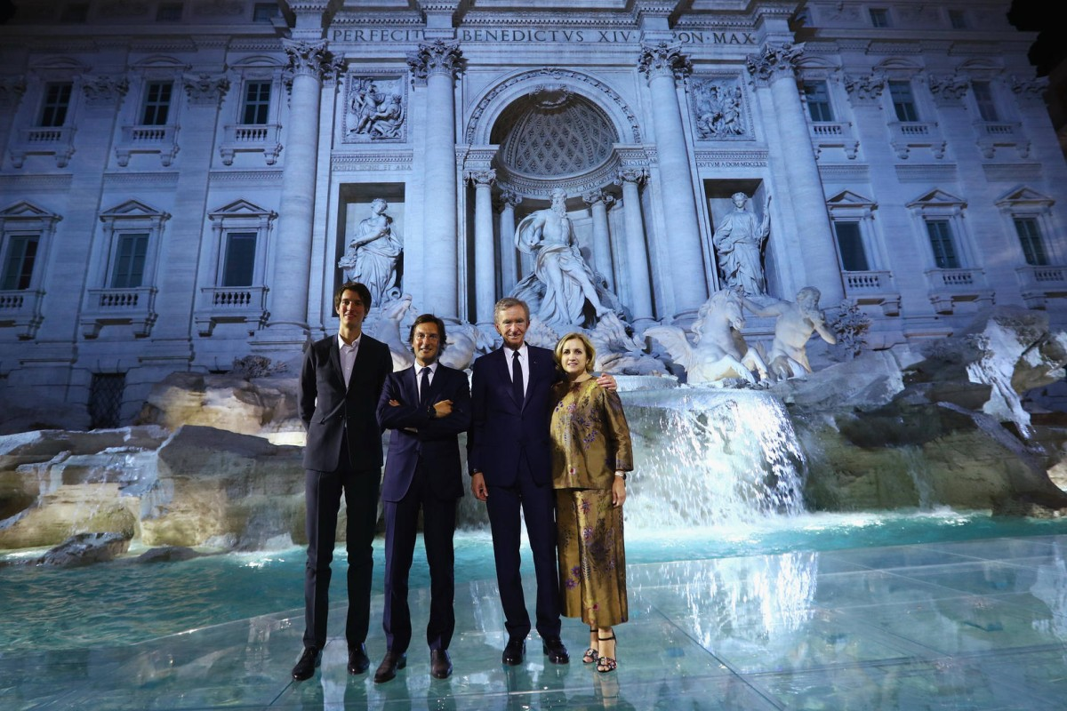 Alexandre Arnault, Pietro Beccari, Bernard Arnault and Silvia Venturini Fendi attend the Fendi 90th anniversary fashion show at Trevi Fountain #stylescmp