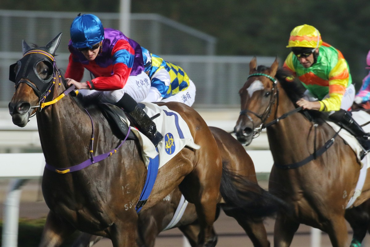 Mighty Maverick (right) holds on to fourth behind Happy Place at Sha Tin on Sunday. Photo: Kenneth Chan