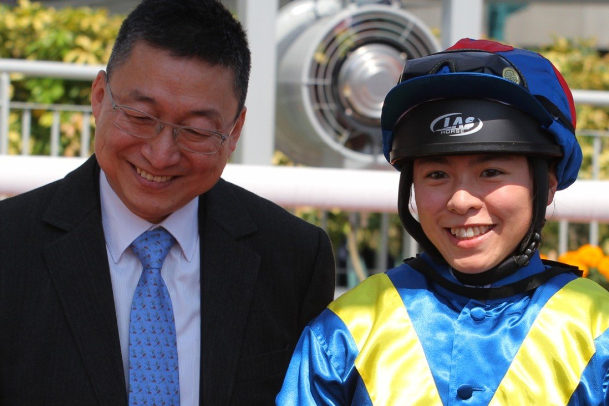 Kei Chiong celebrates with her master Francis Lui after the apprentice scored her first win since returning from injury on Helen's Choice. Photo: Kenneth Chan